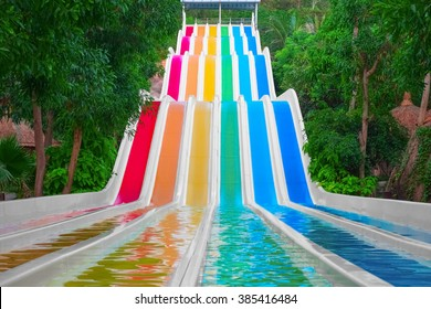 Colorful water slides in tropical aqua park