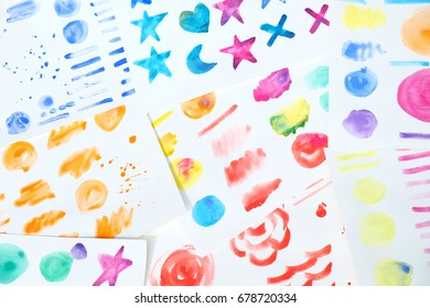 Colorful watercolor in many painted brushes way background on white paper image.