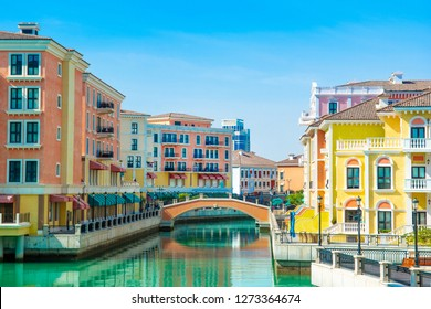 Colorful waterfront buildings in venetian style in the Qanat Quartier, The Pearl Qatar