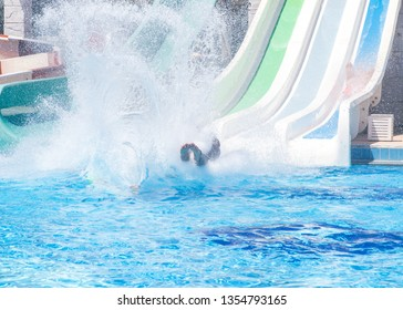 Colorful waterpark tubes, spray slides and pool in aquapark. Water park slides close up.