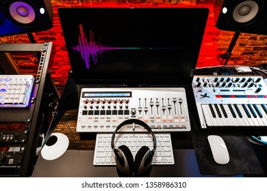 colorful waveform on display in digital sound studio. home recording, broadcasting, editing studio concept