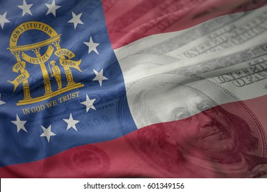 colorful waving flag of georgia state on a american dollar money background. finance concept