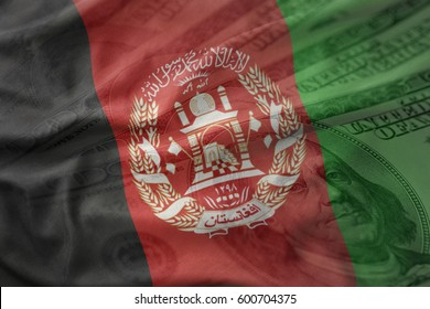 colorful waving national flag of afghanistan on a american dollar money background. finance concept