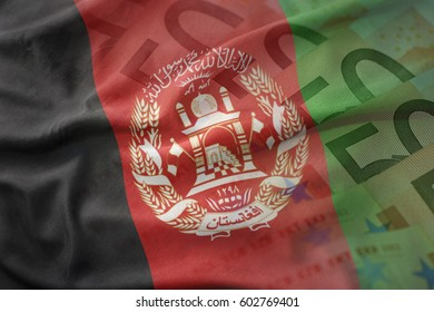 colorful waving national flag of afghanistan on a euro money banknotes background. finance concept