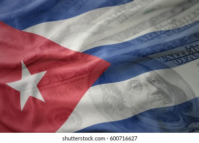 colorful waving national flag of cuba on a american dollar money background. finance concept