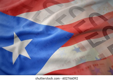colorful waving national flag of puerto rico on a euro money banknotes background. finance concept