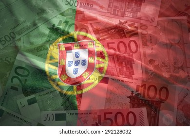colorful waving portuguese flag on a euro money background