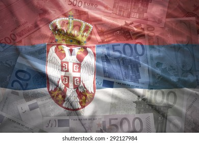 colorful waving serbian flag on a euro money background