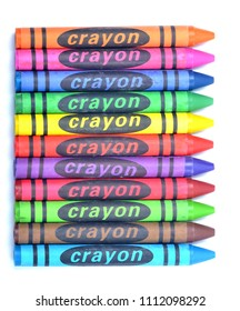 Colorful wax crayons of all colors - lined up isolated on white background