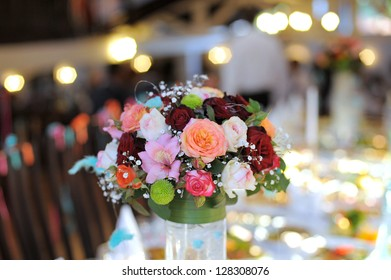 colorful wedding bouquet on festive table in lights