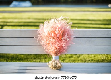 Colorful wedding bouquet on a wooden bench.