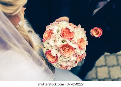 colorful wedding flowers bouquet and young couple