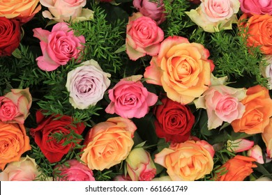 Colorful wedding roses in a floral wedding decoration