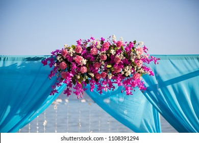 Colorful wedding set-up at the beach.