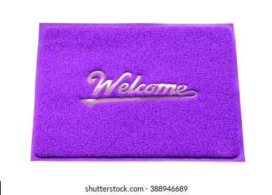 Colorful welcome doormat isolated on white background.