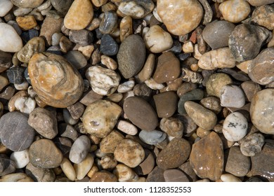 Colorful wet round pebbles