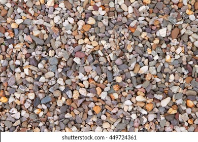 Colorful and white pebbles in different shapes and sizes