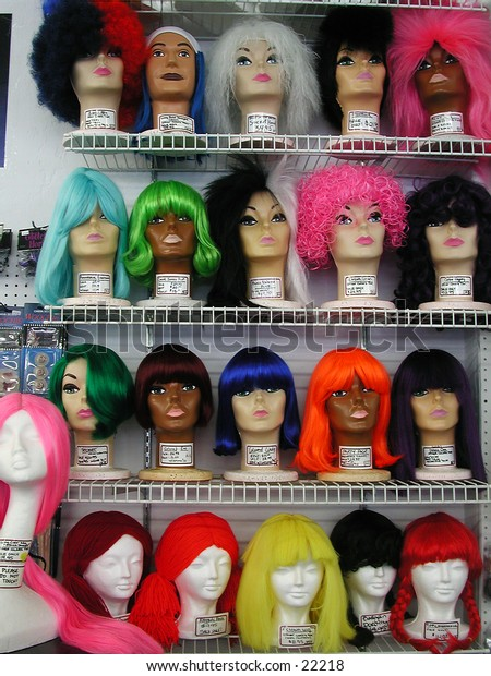 Colorful wigs in a retail store.