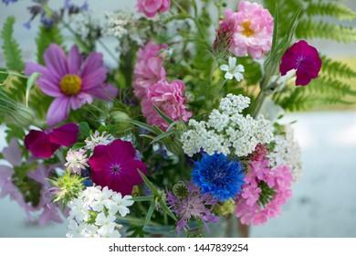 Colorful wild flower bouquet on a summer garden bench