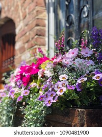 Colorful window box flowers rustic brick