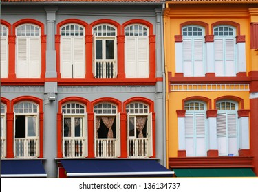 colorful windows facade, public urban street design, old shophouse at china town singapore