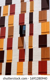 Colorful windows with wooden shutters in Murcia, Spain