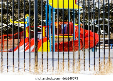 Colorful Wisconsin swimming pool in snow and closed for the winter