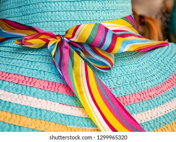 Colorful woman hat focused on the ribbon.