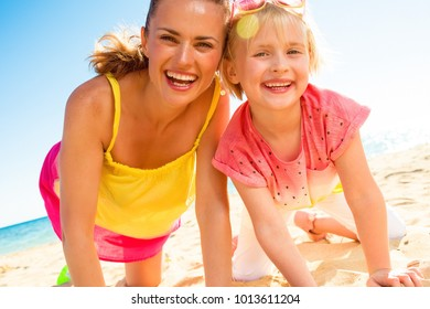 Colorful and wonderfully cheerful mood. happy trendy mother and child in colorful clothes on the beach