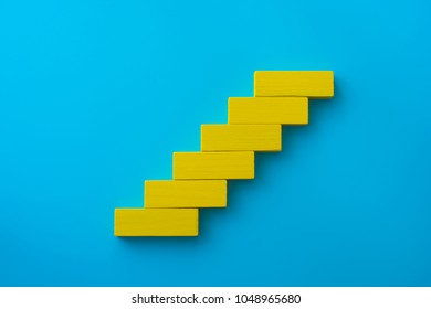 Colorful wood block stacking as step stair. Business concept for growth success process.