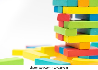 Colorful wood blocks stack game on the table with copy-space, background concept
