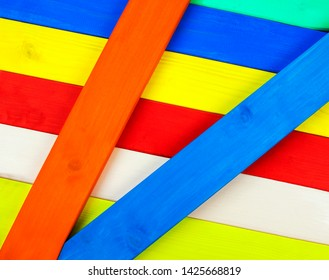 Colorful wood as multicolor stripes in diagonal angles for a bright background textures and design.