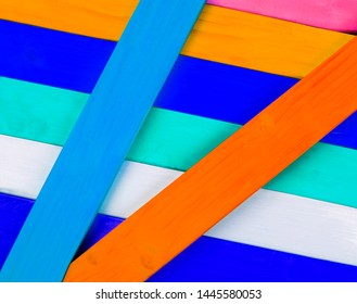 Colorful wood and multicolor stripes and patterns, in diagonal angles as a bright background texture / design.