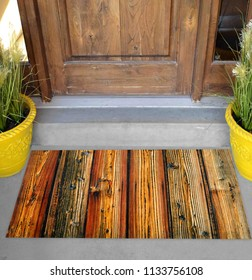 Colorful wood textured rubber doormat outside home with yellow flowers and leaves