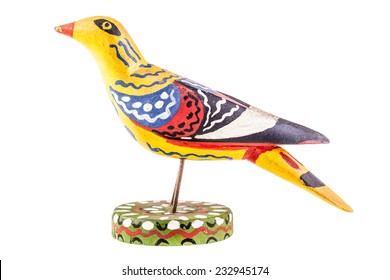 a colorful wooden bird toy isolated over a white background