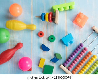 Colorful wooden bricks and plastic toys on wooden background,children's toys