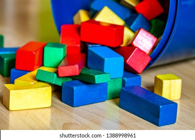 Colorful wooden building blocks on floor - Selective focus