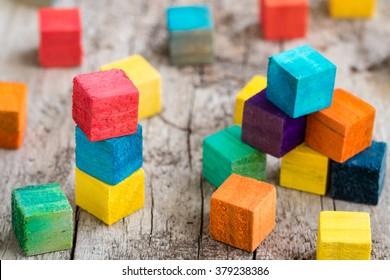 Colorful wooden building blocks. Selective focus