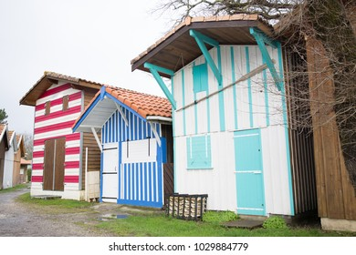 Colorful wooden cabins for oyster fishermen at Biganos Arcachon France