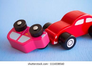 Colorful wooden car crash - Traffic accident auto insurance concept