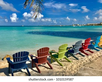 Colorful wooden chairs on the beach of Aruba Caribbean Island
