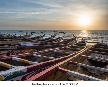 Colorful wooden fisher boat standing on the sandy beach in Senegal. Africa