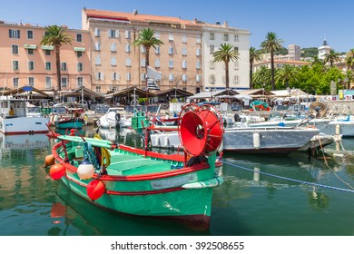 Colorful wooden fishing boats moored in old port of Ajaccio, Corsica, the capital of Corsica, French island in the Mediterranean Sea