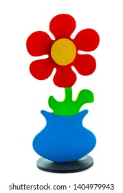 Colorful Wooden Flower in Blue Pot isolated on white background. DIY handmade Artificial Flower gift idea.