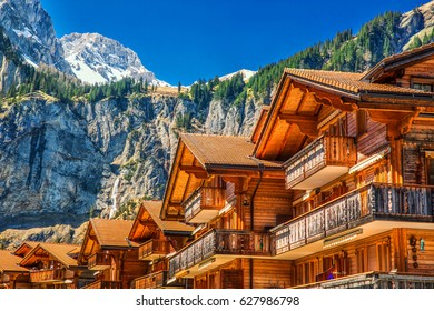 Colorful wooden houses with flowers in Kandersteg village, Canton Bern, Switzerland, Europe.