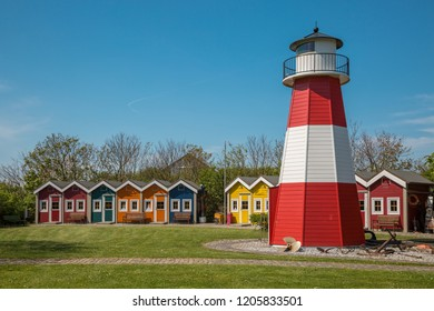 Colorful wooden houses with lighthouse