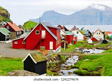 Colorful wooden houses of town Gjogv on seashore of Faroe islands