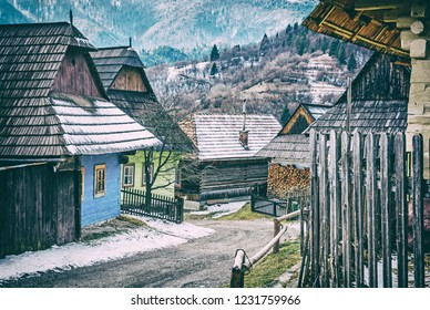 Colorful wooden houses in Vlkolinec village, Slovak republic, Unesco. Cultural heritage. Travel destination. Folk architecture. Analog photo filter with scratches.