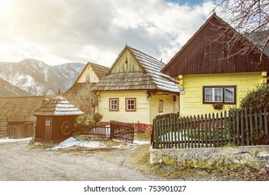 Colorful wooden houses in Vlkolinec village, Slovak republic, Unesco. Cultural heritage. Travel destination. Folk architecture. Yellow sun rays.