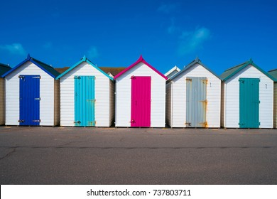 Colorful wooden huts on the beach in Paignton, Devon, UK